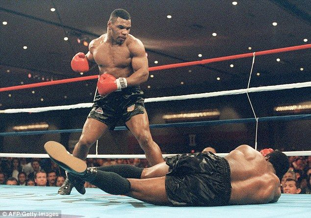 Tyson stands overBerbick after flooring the champion a month before his 21st birthday