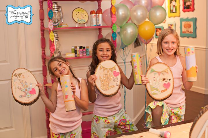 Girly Camping Party: craft projects included painting rainstick cans and fabric/felt art collages on tree stump rounds
