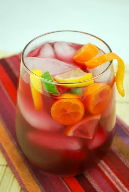 Sangria - love this recipe because it does not have any lime soda, just wine, brandy, triple sec and OJ    1.5 liters red wine (I use Carlo Rossi Sangria)  3/4 cup orange juice  1/2 cup white wine (Sauvignon Blanc or another mild white)  1/2 cup brandy  1/2 cup triple sec  slices of limes, lemons, oranges (optional)
