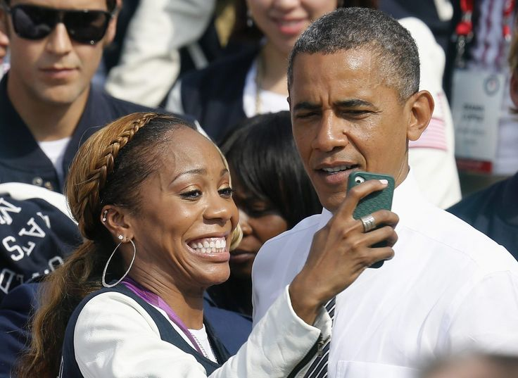 ADMIT IT: You would do this too. U.S. Olympic 400m sprint gold medalist Sanya Richards-Ross takes a picture with U.S. President Barack Obama as the 2012 U.S. Olympic and Paralympic teams visit the White House.