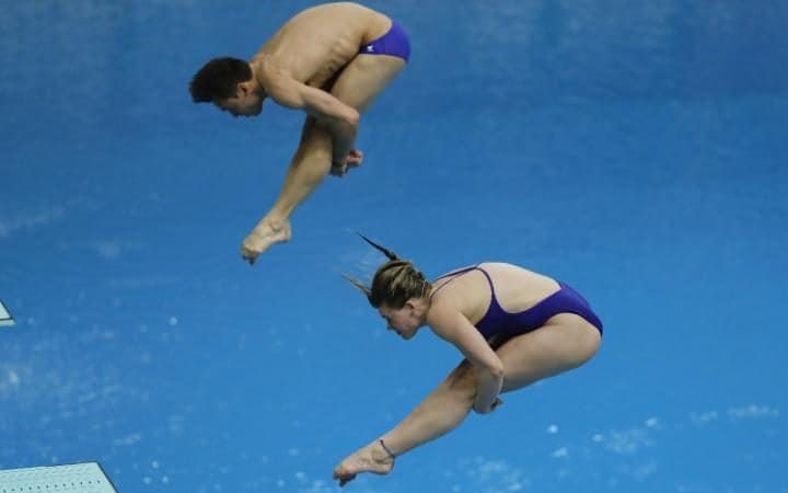Tom Daley and Grace Reid of Great Britain compete in the Mixed 3m Synchro Springboard final on day two of the FINA/NVC Diving World Series 2017 Beijing Station at the National aquatics center-Water Cube.