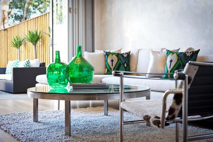 Advantage Property Styling,Living Room, Lounge, Linen Sofa, KAS Cushions, Glass Botlles, Green, Indoor, Outdoor, Shag Rug, Wassily Chair, Cowhide, Reflective, Coffee Table, Cushions, Interior Decorating, Interior Design, Styling