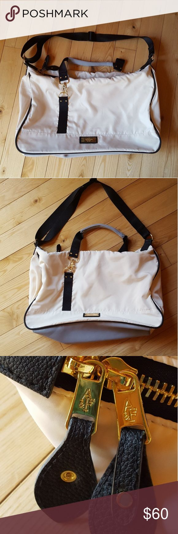 """New Abercrombie and Fitch Bag Nice! BOGO SALE NWOT. Very nicely made bag. Adjustable strap, and the hand strap can be taken off. Zipper in excellent condition. Laying flat the bag is 19"""" a crossed, and is about 14"""" tall. Nice roomy bag. Cream in color. Abercrombie & Fitch Bags"""
