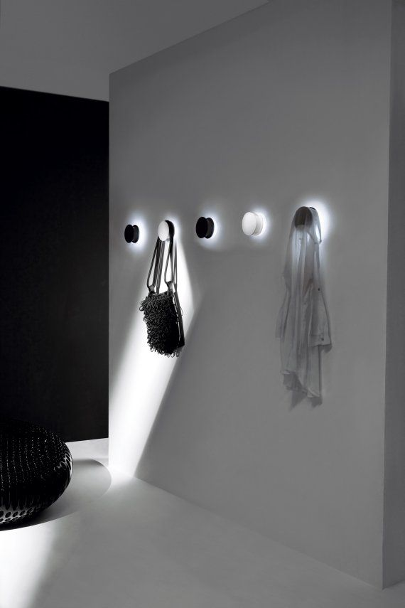The Alone Coat Hook Wall Light by Pallucco