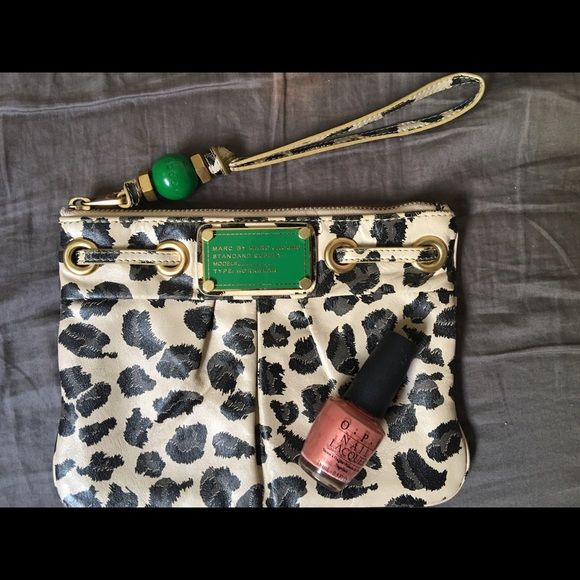 Marc by Marc Jacobs clutch animalier I personally bought this clutch at the Galeries Lafayette in Paris. It is in perfect conditions, very ample, 100% cow leather.  Polish nail not included. Marc by Marc Jacobs Bags Clutches & Wristlets