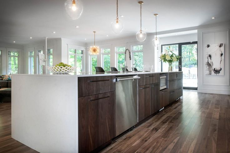 Beautiful kitchen featuring Lauzon's Organik Hard Maple hardwood flooring Charm. This flooring features the exclusive air-purifying technology called Pure Genius technology. Project realized by Brigitte Lafleur. #interiordesign #hardwoodfloor #artfromnature
