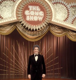 The Gong Show - (1976-1980) & (1988-89). Hosts: Chuck Barris (1976-1980), John Barbour (1976), Gary Owens (1976-77 nighttime) & Don Bleu (1988-89). Announcers: Johnny Jacobs (1976-1980), Charlie O'Donnell (1988-89). Sub Announcer Jack Clark (10-77/12-77).
