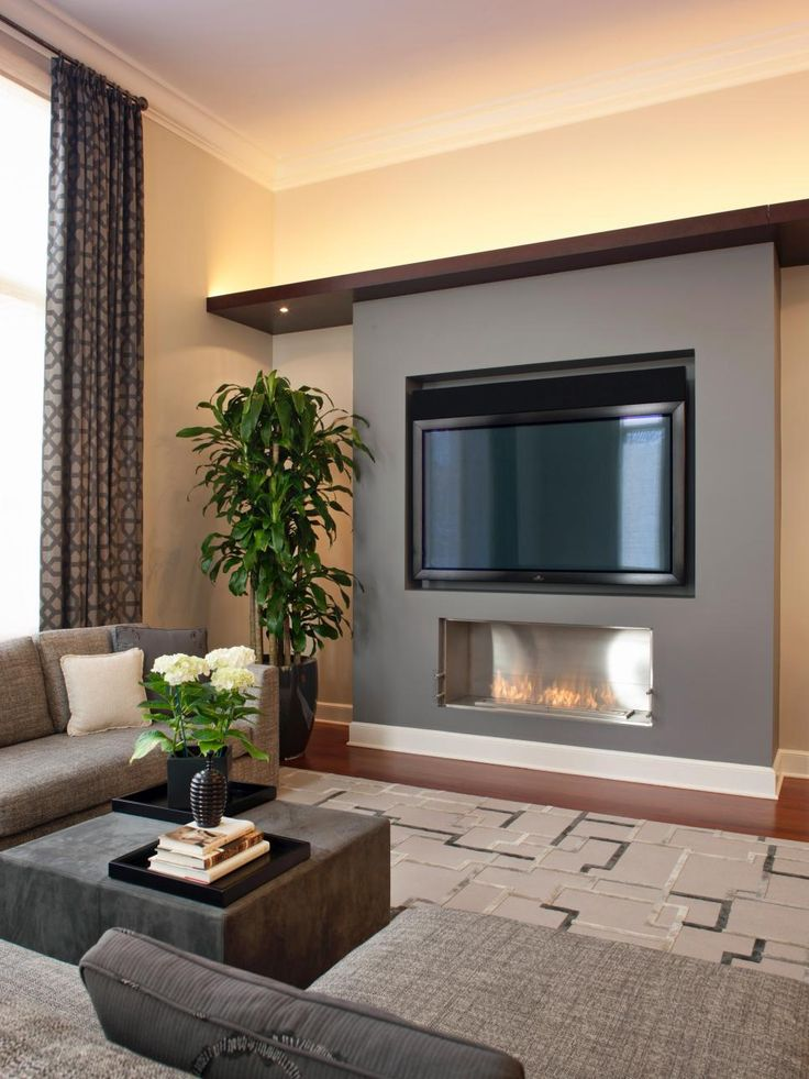 An EcoSmart fireplace adds warmth to the updated family room, with the owners' large TV sitting above.