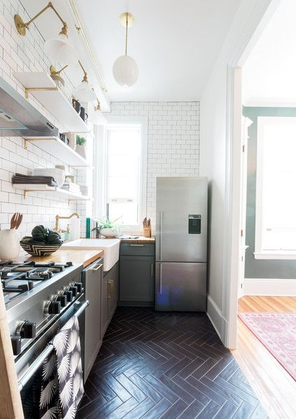 The tile in the kitchen is by Architectural Ceramics and the sconces and pendants by Cedar & Moss and Schoolhouse Electric.
