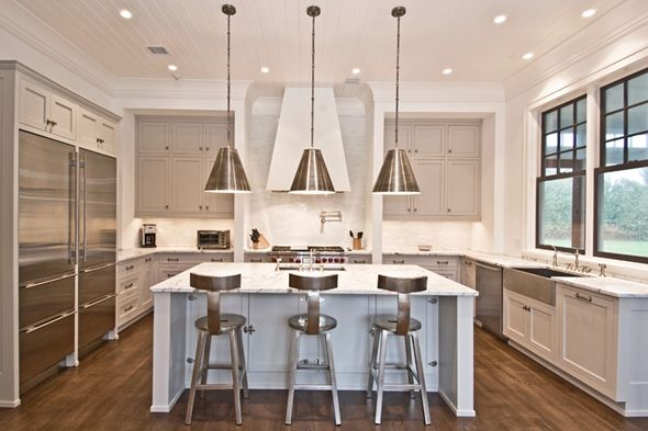 gray cabinetry, range hood, black windows, huge fridge, Goodman pendants, island, stools