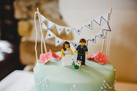 A Lego Inspired Summer Wedding at Hyde Bank Farm. Lego topper wedding cake.   Image by Steven Rooney Photography.  Read more: http://bridesupnorth.com/2016/12/14/never-gonna-let-you-lego-a-summer-wedding-at-hyde-bank-farm-cheshire-ali-dave/  #wedding #cake #Lego