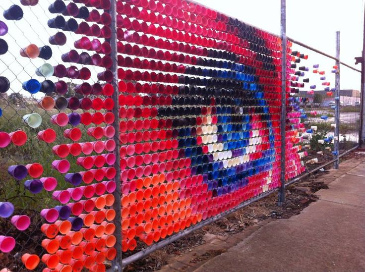 incredible art fence using discarded plastic cups