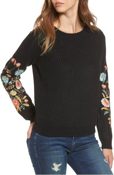 Colorful flourishes of trendy floral embroidery on the sleeves of this comfy sweater make it easy to incorporate color into your cold-weather wardrobe.