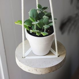 Learn how to make this adorable hanging cement table to display some of your plants.