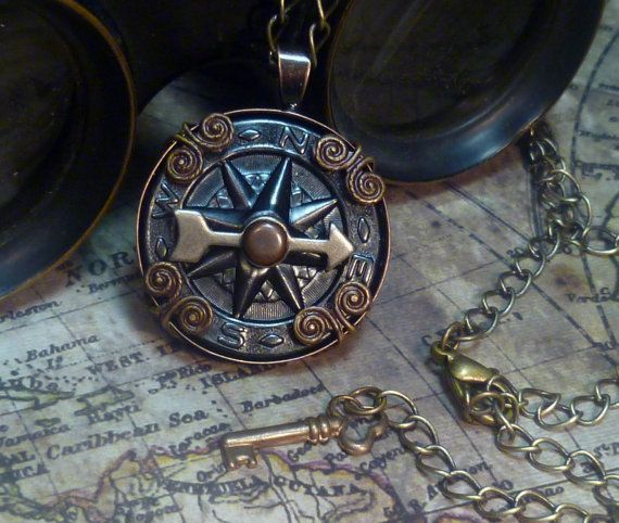 Steampunk Airship Navigator's vintage 1 inch round compass in antique copper and brass with embossed Victorian details. Vintage metal game spinners re-purposed as compass needles to guide your airship with antique brass filigree that hugs the pendant.