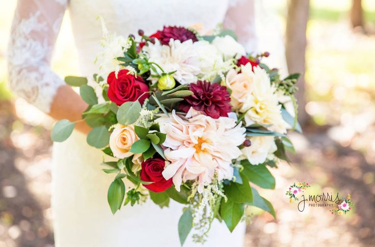 Amazing dahlias and roses hint at an antique look, just right for that elegant fall wedding....by Clara's Flowers of Kansas City