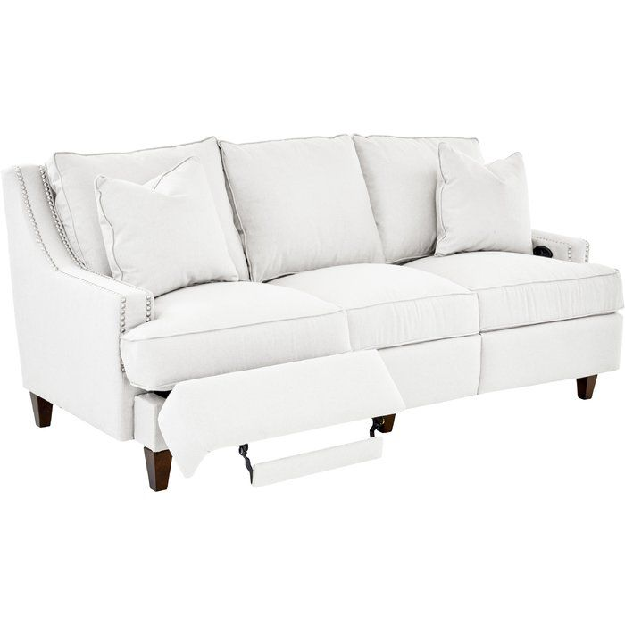 This transitional sofa highlights beautiful style details and accommodating design. Featuring a power reclining mechanism operated by a button inside the arm, the sofa showcases tall exposed wood legs and track arms with nail head trim. With comfortable down blend cushions and loose back pillows