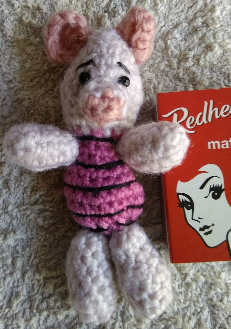 """My ugly little Piglet of Pooh and Piglet Piglet fame.  Pattern from """"Winnie the Pooh Crochet"""" by Megan Keiser. The book comes in kit form with wool, crochet hook, Stuffing, felt for eyes and embroidery thread with a Darning needle. Ditch the wool, it is awful to work with."""
