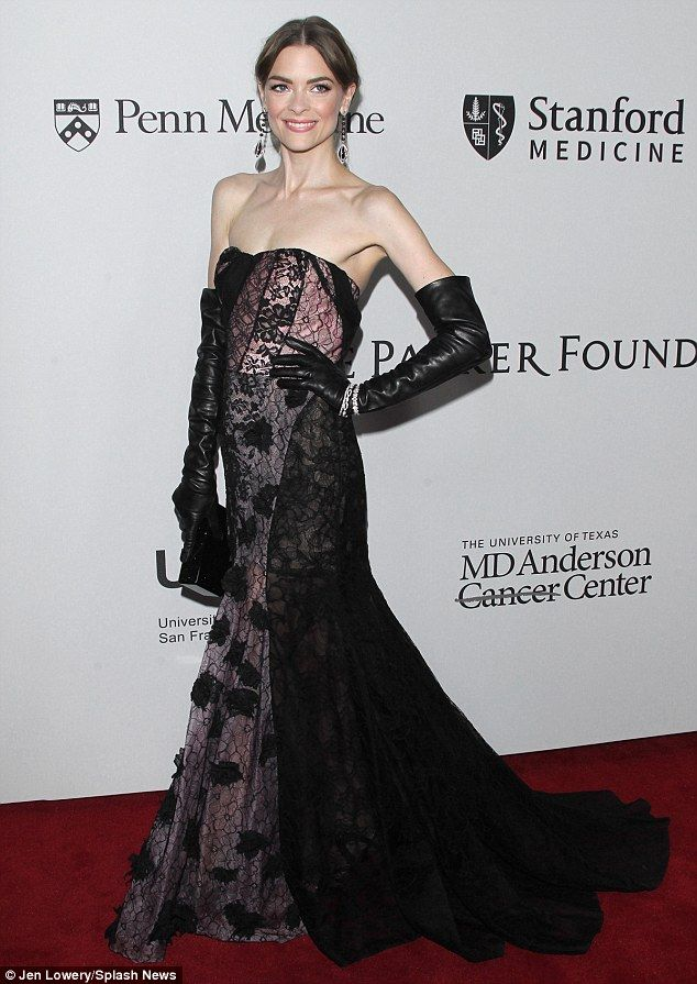 Willowy: Jaime King showcased her slender figure in a long fishtail gown as she arrived at...