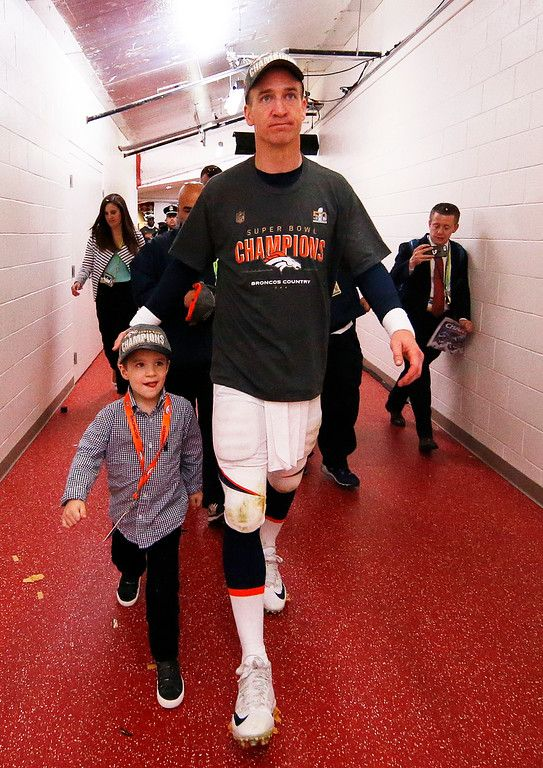 . Peyton Manning #18 of the Denver Broncos walks with his son Marshall Manning after defeating the Carolina Panthers during Super Bowl 50 at Levi\'s Stadium on February 7, 2016 in Santa Clara, California. The Broncos defeated the Panthers 24-10.  (Photo by Ezra Shaw/Getty Images)