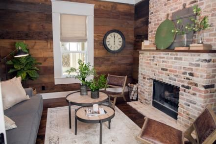 The+front+section+of+the+house+was+reconfigured+to+incorporate+his-and-hers+office+spaces.+This+one+features+a+fireplace+with+original+century-old+brick+and+dark+stained+shiplap+paneling.