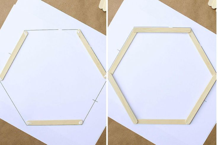 Add some mid-century charm to your gallery wall with this DIY wall art idea. All you need is popsicle sticks, glue and some stain to make this inexpensive home decor knockout. Click to see the full tutorial and download the free hexagon template.   MakeAndDoCrew.com