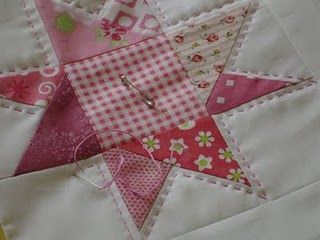 Love this wonky star with big-stitch hand quilting!  Love the pink!