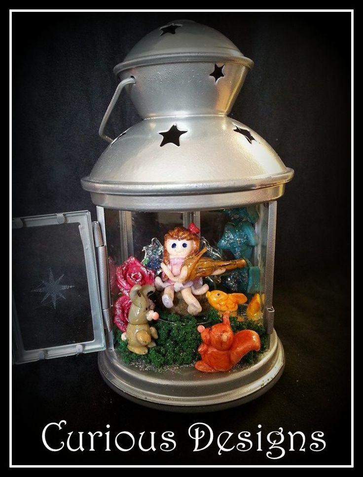 Fairy dell in a lantern #fairy #fairys #faries #magical #magic #music #violin #rabbit #squirrel #fish #pond #lantern #farydell #secret #curiousdesigns #ladyopheliaravenlovelace