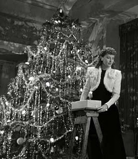 """§§§ : Barbara Stanwyck tinsels the tree in the movie """"Christmas in Connecticut"""""""
