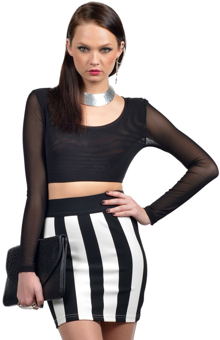 Invoke your inner 90's style icon with this gorgeous black mesh crop top featuring long sleeves. Wear with a high waisted bodycon skirt, statement necklace and bowler hat. Length: 28cm. Width: 27cm. Available online at www.ilovethelot.com