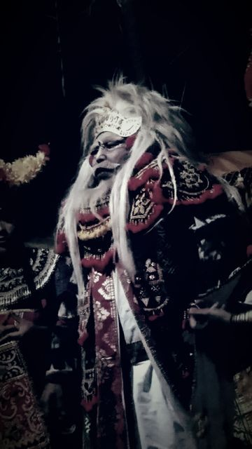 The Topeng dancer is a popular character in the night time performances during a temple ceremony.
