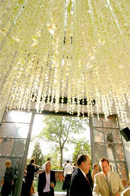 Bring the outside inside for your reception with flowers hanging from the ceiling