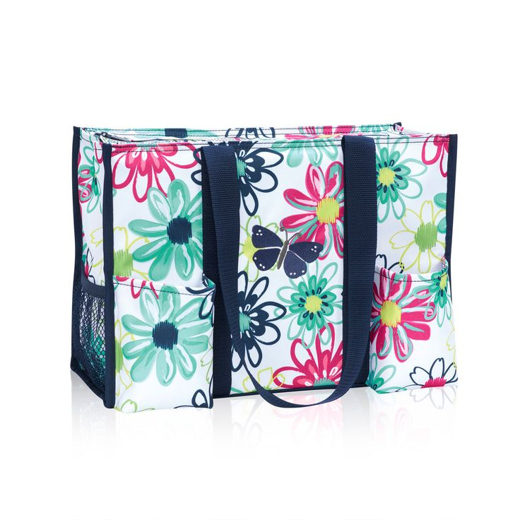 "The same size as our classic Organizing Utility Tote, with seven pockets for all your essentials, plus a convenient zipper to keep everything safe and secure! Approx. 10.75""H x 14.5""L x 6.5""D"