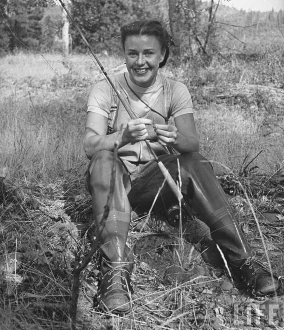 Ginger Rogers fly fishing on her ranch in Oregon. Life Magazine.