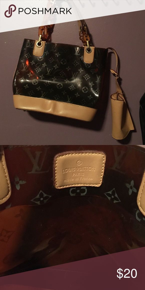 Louie hard plastic coating with attached wallet A bit worn but still good condition, was a gift so not sure if authentic, even though it looks it to me since branding is there Bags Shoulder Bags