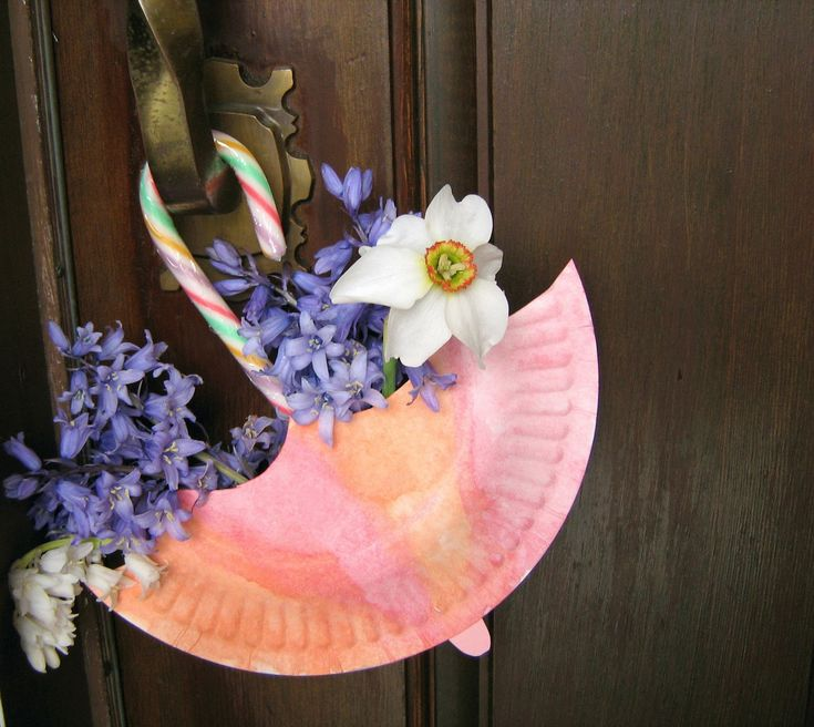 April showers bring May flowers   And what do these May flowers bring?  Happy thoughts and sunshine smiles  And wishes for a wonderful Spring!  May Basket made from a dessert sized paper plate and a candy cane