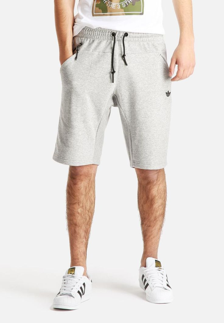 Both sporty and stylish, these shorts lend themselves to downtime dressing. Constructed from soft fleece with a ribbed crotch panel, they also have a zip pocket and a textured silicone Trefoil on the hip. A graphic tee and statement sneakers will elevate this look.