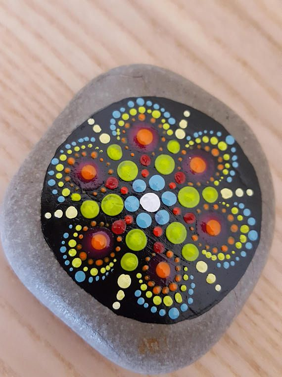 mandala decorated stone proctected with transparent paint