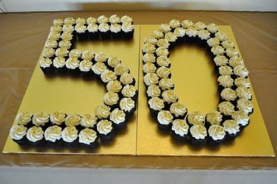 Cupcakes spelled out in the big 5-0.  See more planning a 50th birthday party ideas at www.one-stop-party-ideas.com