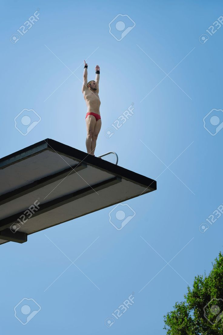 Male Diver, Preparing To Dive From 10 Meter High Diving Platform ...