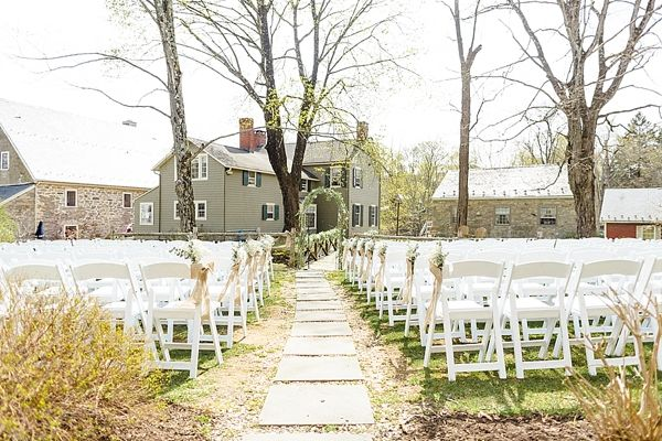 Outdoor ceremony seating at Inn at Millrace Pond | Photo by Christy Nicole Photography | Rustic Inn New Jersey Wedding on heartlovealways.com
