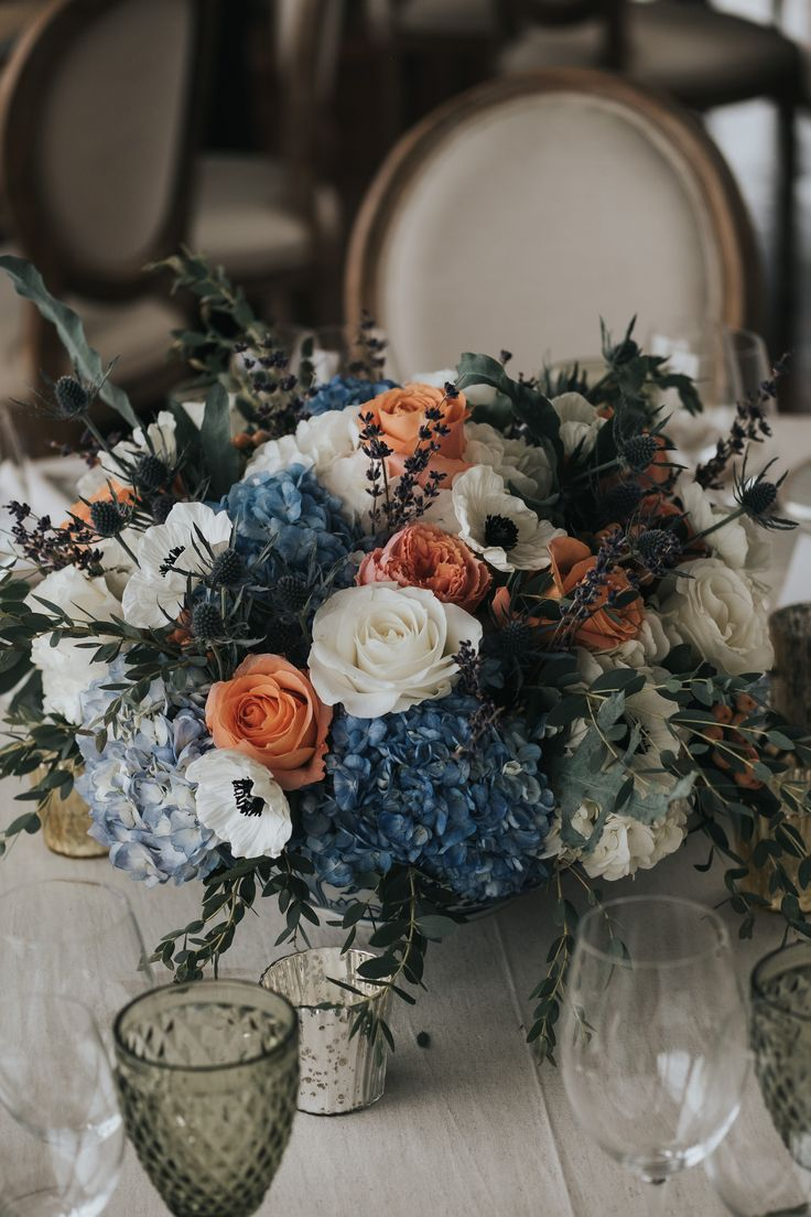 Coral, blue and green wedding centrepiece; PHOTOGRAPHY Joel + Justyna Bedford, destination wedding photographers
