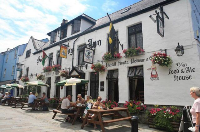 "(PHOTO: black-boy-inn.com)  Ten of the best: old British pubs  11 - Black Boy Inn, Caernarfon, Wales  Built circa 1522, the Black Boy Inn is one North Wales' oldest inns and has been a retreat for weary travellers for centuries. According to the website, it's thought that the origins of its name either relates to a ""to a black boy brought into the country on a ship"" or to ""a navigational buoy which existed in the harbour in the early days of the Inn"". black-boy-inn.com"