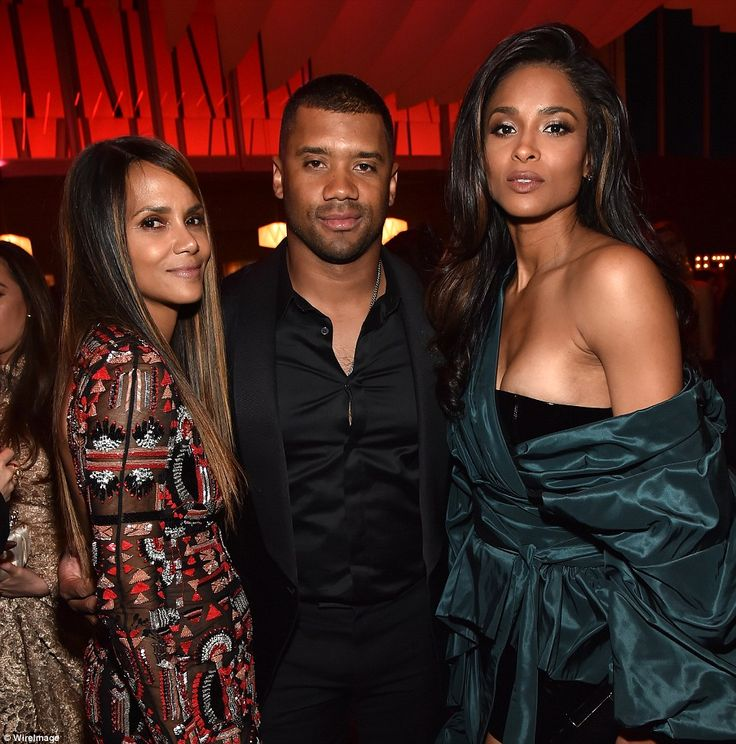 Goodies: Seatlle Seahawks quarterback Russell Wilson poses with former Oscar winner Halle Berry (left) and wife Ciara (right)