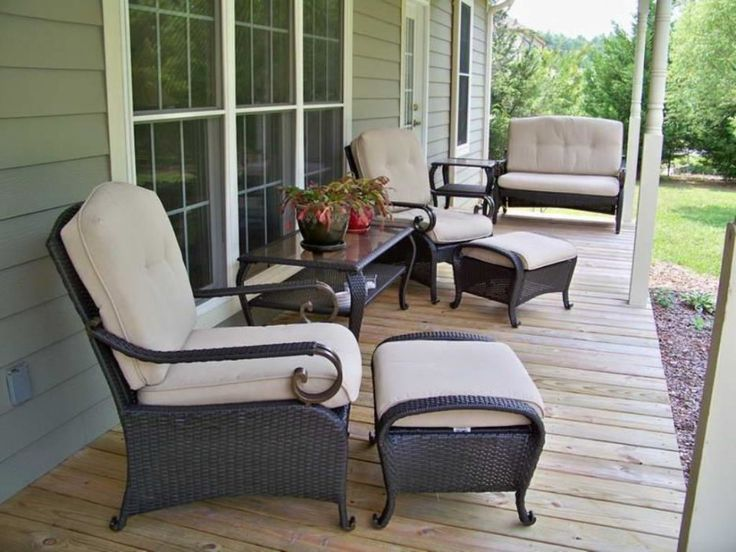 Furniture. Dark Wicker Porch Ottoman Chairs and Glass Topped Porch Table on Light Wooden Porch Floor. Breathtaking Porch Furniture Set Ideas