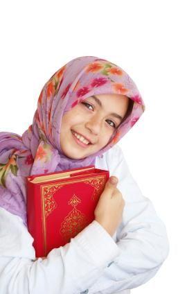 Muslim girl holding Quran