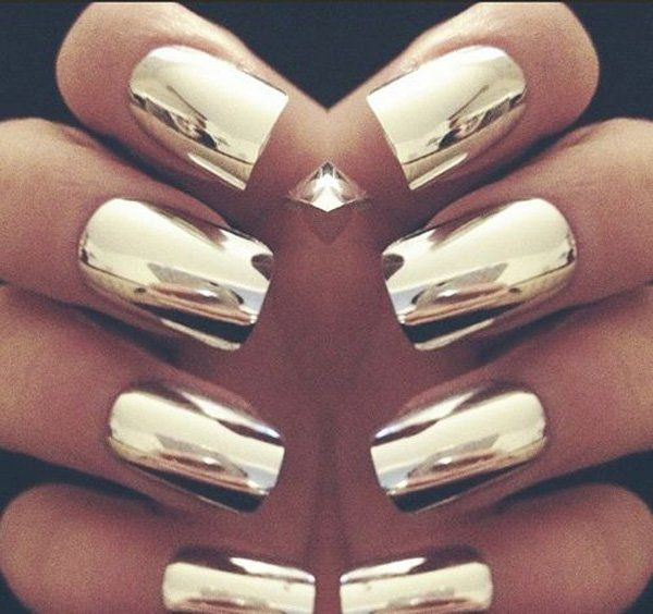 Create a statement by making a full gold metallic foil inspired nails.