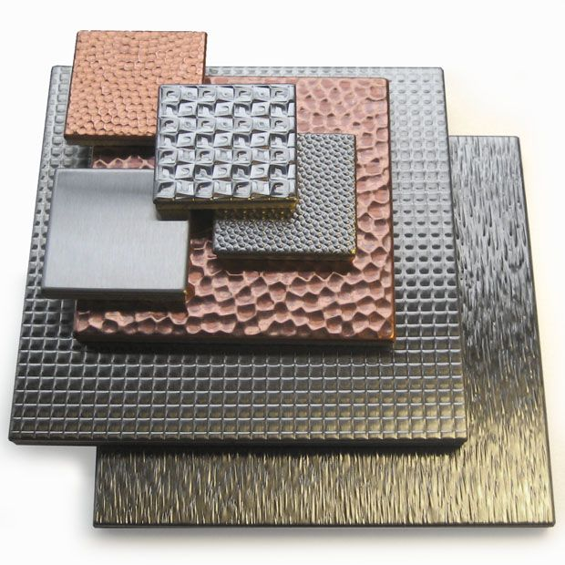 Stainless steel or copper tiles for a backsplash the kitchen... (Great website for small quantity metal orders)