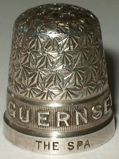 """Sterling silver souvenir GUERNSEY """"Spa"""" thimble by Henry Griffith & Sons of Leamington Spa. Daisy pattern top over reeded border with the island place nameGUERNSEYin relief. Also stamped""""THE SPA""""on the rim with hallmarks:H.G&S(for Henry Griffith & Sons), the Birmingham Assay Officeanchor mark, thelion passantfor sterling silver, the date letter upper case""""F""""for 1930 and14(the size)."""