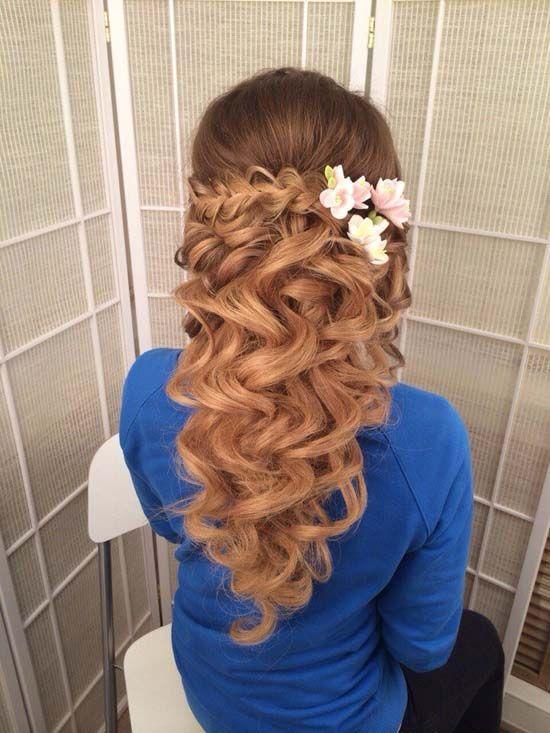 long wavy half up half down wedding hairstyle with pink flowers via antonina roman
